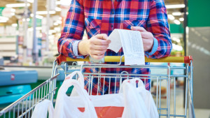 Woman housewife looking check in the store